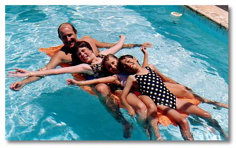 In Grandparent's swimming pool in Florida with Uncle Bob, Cousins Sarah and Lauren.