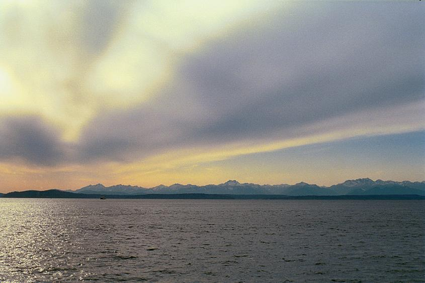 The Olympic Range in the distance over the sound.